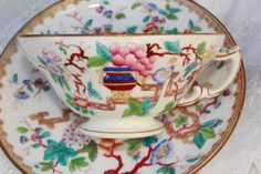 Mintons, tea cup and saucer, hand painted