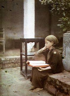 child with a book / Autochrome Lumière: an early color photography process. Patented by the Lumière brothers in France (1903) and first marketed in 1907. It was the principal color photography process in use.