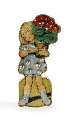 Mette Saabye. Brooch: Cookiegirl, 2006. 18 ct. gold, scrap, turquoise. 1 x 4 x 8 cm.