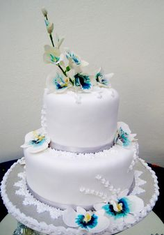 Classic white cake with silver and blue accents