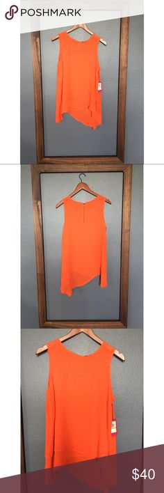Vince Camuto Poppy Bloom Tank Brand new with tag! Gorgeous bright orange color with an asymmetrical hemline. 100% rayon. Vince Camuto Tops Tank Tops