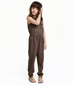 Check this out! Sleeveless jumpsuit in a soft, woven viscose. Concealed snap fasteners at front, chest pockets with flap and button, elasticized seam with drawstring at waist, and side pockets with visible zip. Elasticized hems. - Visit hm.com to see more.