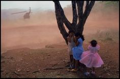 El Salvador, 1984. Army evacuated wounded soldiers from village football field. Credit : James Nachtwey]