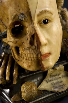 """Wax vanitas, Europe, 1701-1800: """"Vanitas are works of art intended to remind the viewer of the shortness of human life, the uselessness of vanity and the certainty of death. This example features many symbols typical for this type of object, such as a skull and insects that feast on decaying flesh. The other side of the model shows the face during life. The verse scratched on to the front is from the biblical book of Ecclesiastes and reads vanity of vanities, all is vanity."""""""