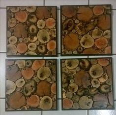 4 cuadros con rodajas de diferentes maderas, montados en triplay de meple y marco de pino entintado al chocolate.