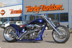 """The """"Blue Flame"""" (Thunderbike Freestyle) in front of our store."""
