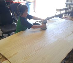 8yo David wanted to help me sand the table top.  #woodworking #workshop #handmade #oklahomawoodworking #oklahoma #veteranmade #madeinoklahoma #furniture #table #farmtable #country #vintage #antique #antiquefinish #plane #handplane #handtools #handcrafted #local #customfurniture #custommade #rustic #rusticdecor #rusticfurniture #farmhouse #countrykids #country #hardwork by hearth_and_homestead.brad