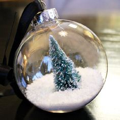 Create your own personal Christmas scene in the palm of your hand with this simple DIY snow globe ornament!