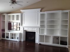 DIY built-in fireplace surround, entertianment center and bookshelves. I love this....
