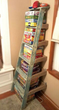 11 Surprising Ways To Reuse Your Household Clutter - this is a great way to get . 11 Surprising Ways To Reuse Your Household Clutter – this is a great way to get the games out of Ladder Shelf Diy, Old Ladder, Ladder Storage, Wooden Ladder, Stair Storage, Storage Room, Ladder Decor, Board Game Storage, Board Game Organization