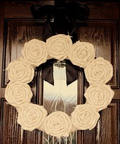 Burlap rosette wreath--this one looks fairly simple, so it might be more my speed than some of the more complicated wreaths.