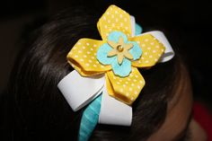 hand made headbands on a plastic headband by AnasKreations on Etsy, $7.00