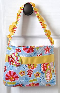 Little girl purse @Erynn Nelson; love the bright cheeriness and ruffle on the strap 1/9/12