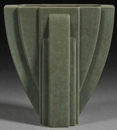 A Claude Dumas Art Deco pottery vase, molded glazed earthenware, France, second quarter 20th century, reverse arch form, matte olive green glaze