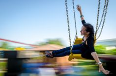 flying lady - trying out a panning shot in flying chairs at an amusement park