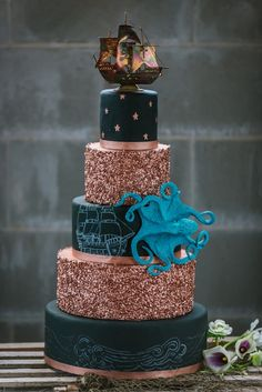 Black and Gold Glitter 5-Tiered Nautical Inspired Wedding Cake with Pirate Ship Cake Topper and Octopus Details