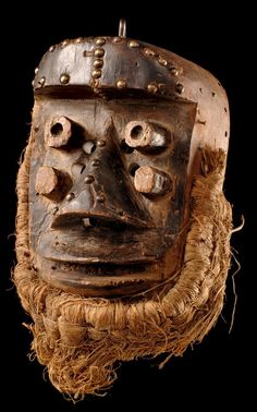 Africa | Face mask from the Grebo people of the Ivory Coast | Wood, brass tags and fiber
