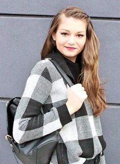 Large gingham print sweater, flattering black trousers, and black leather booties. Perfect autumn style.