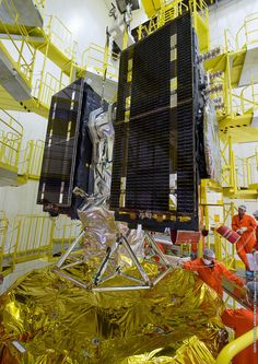 Twin satellites for Europe's Galileo navigation system were raised on top of a Russian-made Soyuz rocket late Tuesday and installed for Friday's launch from French Guiana to expand the growing network of spacecraft nearly 15,000 miles above Earth.
