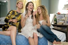 Cynthia Nixon, Kristin Davis and Sarah Jessica Parker relax in Carrie Bradshaw's apartment in the film version of Sex In The City