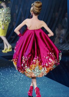 Christian Dior, sp;ring 2008 - WTH? This dress makes someone look like an upside-down cupcake! and in that color! (While we're at it, someone needs to FEED this gal - I don't need to see all her bones of her back and arms!!)