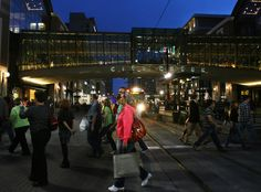 People walking across Main Street near City Creek Center