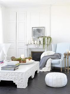 White room herringbone floor ornate coffee table, quiet palette