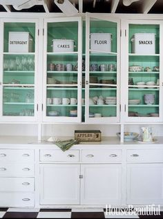 This celadon hue takes white from blah to beachy when peeking out from behind the cottage kitchen's glass-front cabinets. You can achieve a similar look with South Beach by Benjamin Moore. Click through for more of the best kitchen paint colors.