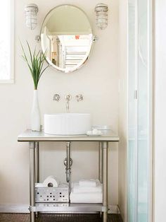 small bathroom:  kitchen cart vanity with wall-mount faucet.