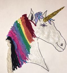 100 days of school idea. Unicorn with 10 colors and 10 strands of hair in each color. Yarn hair and White and gold glitter.