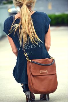 Casual distressed tee with leather satchel