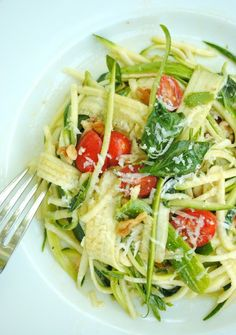 "Zucchini Pasta! ""In a large bowl, combine garlic, tomatoes, walnuts, basil, salt and oil. Let sit for about 20 minutes. Toss with zucchini (cut into thin strips)!"