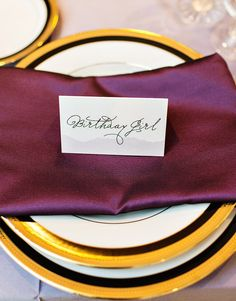 Glam Garden Inspired Ombre Purple 30th Birthday Party. Beautiful purple linen napkins with gold-rimmed plates.
