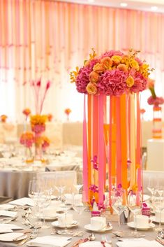 We could recreate this in your colour scheme using teal, royal blue and purple ribbons with a floral posy of lilies and roses at the top - £35