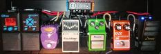 Light Duty board the Pedaltrain Metro 24- Preamp: Donner Wah Cry, DOD Compressor 280, Ibanez Tube Screamer TS9, Boss GE7 Equalizer, Dan Electro Chromatic Tuner | thru FX Loop: Zoom G1on (presets edited for use only with time based & modulation FX; programmed with Chorus, Flanger, Phased, Delay, & Reverb FX)