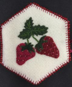 Strawberries--The stem are a chain stitch using #8 pearl cotton; veins in the…