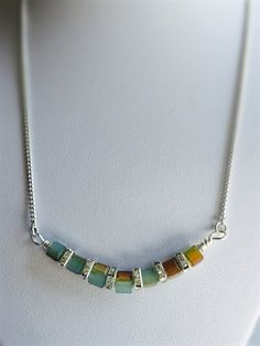 Green multicolor cube necklace made with a green cube crystal and cube rondelle complement with sterling silver chain. Measure: 16 inch