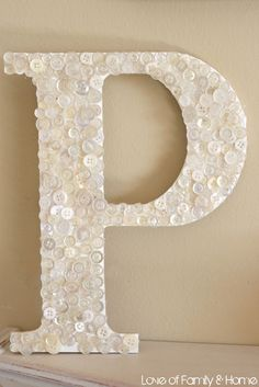 DIY Button Covered Monogram. It would be cool to have your and your roommate's initials!