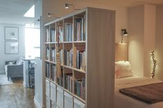 A few drunken sketches and debates at IKEA helped this stylish couple create a smart layout in their simple 640 square foot Chicago studio.