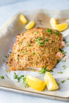 A large piece of salmon baked and coated with a crunchy mustard-panko crust, sliced into 3 sections.