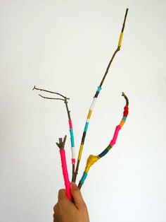 thread-wrapped twig summer diy idea  Love this idea especially for maybe a small clear vase with little pebbles in it