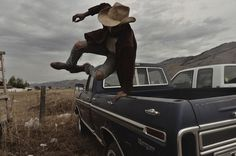 cowboy and pick-up truck