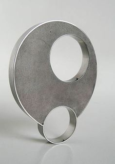 "Checha Sokolovic: Ring in cement and stainless steel. 2 1/4"" high (including shank) x 1 3/4"" wide x 1/4"". Ring size 7.5."