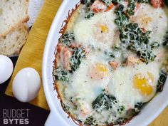 These amazingly flavorful baked eggs with spinach and tomatoes are the easiest way to impress your guests. Just layer the ingredients together and bake!