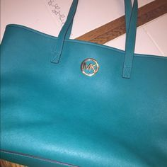 Michael Kors tote In great condition. One small pink ink marking on inside. Great to Carry laptop in or for traveling.  Bought for over 200. Make an offer. Michael Kors Bags Totes