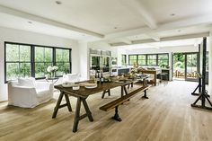 James Perse's Malibu Farmhouse. Trestle table/bench combination. Easel TV.