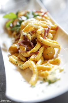 Traditional 'Passatelli' - delicious pasta from Bologna made with Parmesan, breadcrumbs and egg. http://www.yummy-italy.com/