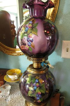 Beautiful! A lovely and very feminine purple antique lamp. It looks like it was an oil lamp before it was converted to electric.