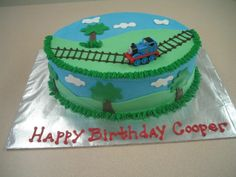 Cooper's - Thomas the Train cake for a little boys birthday. Last minute order so the cake is not nearly as detailed or polished as I would like but the customer was thrilled. Butter cake, strawberry mousse filling, vanilla BC. All decorations are fondant except for Thomas who is, of couse, a toy :). Thanks to all for inspiration!