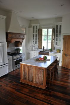 Corbels holding cooktop hood, antique doors, reclaimed bead board on island, antique shutters. Elements found at The Corbel. Concrete Furniture, Beauty Kitchens, Home Kitchens, Wooden Kitchen, Kitchen Design, Paint Cabinets White, Wooden Bread Board, Beautiful Kitchens, Cottage Kitchens